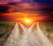 Fork roads in steppe on sunset sky background Stock Photography