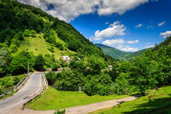 Fork roads to the mountain village. Fork roads leading to the village in the mountains stock images