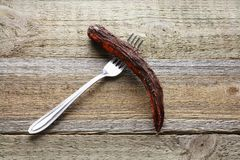 Fork with Rotten Carrot. On Wooden Background Royalty Free Stock Images