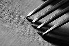 Fork on rough fabric textured background Stock Photography