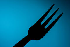 Fork& x27; s i blå bakgrund Royaltyfri Bild