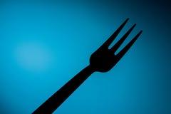 Fork& x27; s i blå bakgrund Fotografering för Bildbyråer