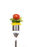 Fork Salad. Salad vegetables on a fork ready for a delicious bite Stock Photo