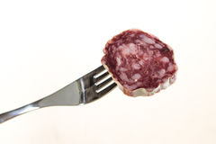 Fork and salami Stock Photography