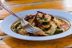 Fork is scoop to pork. Sliced grilled beef salad. Thai menu. At thailand Royalty Free Stock Image