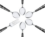 Fork and set of spoons Royalty Free Stock Photography