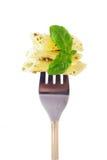 Fork with snack- pesto. Fork with snack: pesto pasta whit fresh basil Stock Images