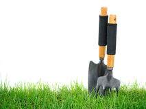 Fork and spade on the green grass Royalty Free Stock Images
