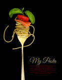 Fork with spaghetti, tomato, salmon and basil Stock Photography