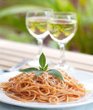 Fork with spaghetti with tomato sauce and basil Royalty Free Stock Photos