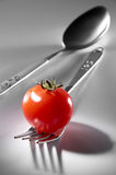 Fork And Spoon. With fresh tomato Stock Images
