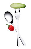 Fork and spoon. Isolated object, some vegetable Stock Image