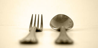 Fork and spoon. On off white background Stock Images