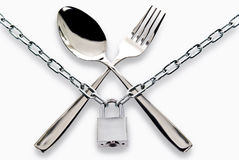 Fork and spoon armored chain and padlock Stock Image