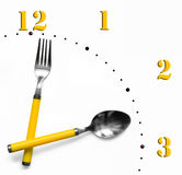 Fork and spoon as clock hands. A fork and spoon as hands on the face of a clock Stock Images