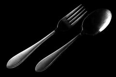 Fork and spoon on black. Background Royalty Free Stock Images