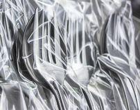 Fork and spoon in  clear plastic bag Royalty Free Stock Image
