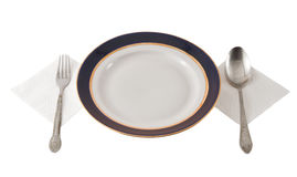 Fork And Spoon Crossed On Plate Royalty Free Stock Images