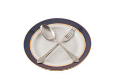Fork And Spoon Crossed On Plate Stock Photography
