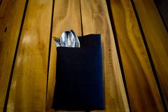 Fork and spoon in dark blue cloth,on wooden table background Royalty Free Stock Photography