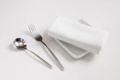 Fork,spoon,dish and  tablecloth. Fork,spoon ,dish and  tablecloth on white clothe table Royalty Free Stock Photos