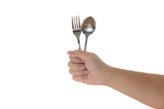 Fork and spoon held by a man's hands  Royalty Free Stock Image