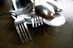 Fork and spoon included in the plate on the wooden table stock image