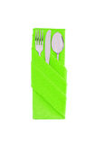 Fork, spoon and knife in green cloth isolated on white. Background Royalty Free Stock Photography