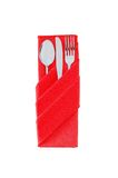 Fork, spoon and knife in a red cloth isolated on white. Background Stock Photography