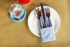Fork-spoon-knife on white plate Stock Photography