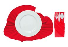 Fork, spoon, knife and white plate on red cloth isolated on whit Royalty Free Stock Photography