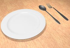 The fork and spoon lie near a plate. On a table Royalty Free Stock Images