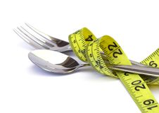 Fork and spoon with a measuring tape Stock Photography