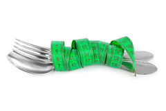 Fork spoon and measuring tape Royalty Free Stock Photo