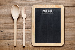 Fork and spoon and menu blackboard Royalty Free Stock Image