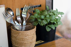 Fork and spoon with plant decorated Stock Photo