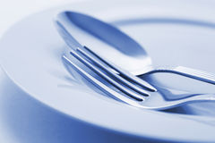 Fork and Spoon on Plate Stock Images