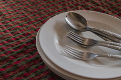 Fork and spoon. Fork spoon plate dish tablecloth Royalty Free Stock Photos