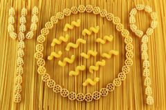 Fork, spoon and plate made of spaghetti and pasta royalty free stock images