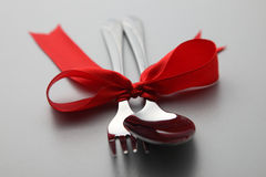 Fork and spoon with ribbon Royalty Free Stock Images