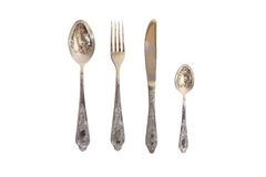 Fork, spoon, small spoon and knife Stock Image