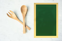Fork and spoon on table Royalty Free Stock Images