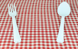 Fork and spoon on tablecloth. For food serving background Royalty Free Stock Photo