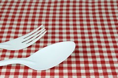 Fork and spoon on tablecloth. For food serving background Stock Photos