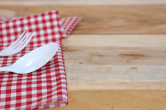 Fork and spoon on tablecloth for food serving background Royalty Free Stock Images