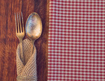 Fork and spoon. Vintage toned picture of the fork and spoon lying at the old table Stock Photo