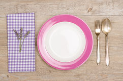 Fork and spoon with violet napkin Royalty Free Stock Photo