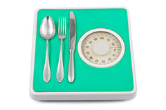 Fork and spoon on weight scale Stock Image