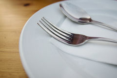 fork and spoon with white plate Royalty Free Stock Images