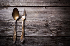Fork and spoon on wooden background Royalty Free Stock Photos